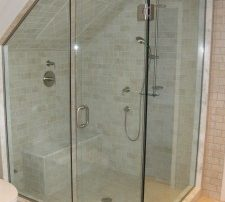 Corner steam shower with slanted ceiling